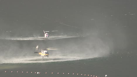 Helicopter-Refilling-Water-Drop-After-A-Brushfire-Holser-Fire-Burns-A-Hillside-Near-Lake-Piru-California-2