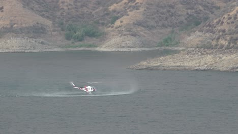 Helicopter-Refilling-Water-Drop-After-A-Brushfire-Holser-Fire-Burns-A-Hillside-Near-Lake-Piru-California-6