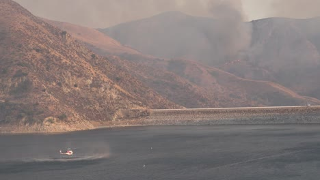 Helicopter-Refilling-Water-Drop-After-A-Brushfire-Holser-Fire-Burns-A-Hillside-Near-Lake-Piru-California-7