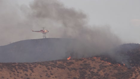A-Helicopter-Makes-A-Water-Drop-On-A-Brush-Fire-In-The-Hills-Of-Southern-California
