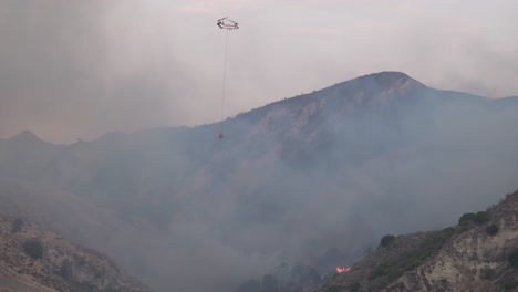 A-Helicopter-Makes-A-Water-Drop-On-A-Brush-Fire-In-The-Hills-Of-Southern-California-1
