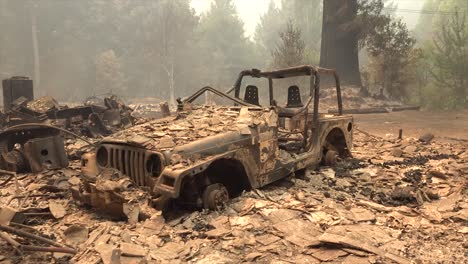 Ruins-Of-A-Burned-House-And-Jeep-And-Ash-During-Devastating-August-Lightning-Complex-Fire-In-Santa-Cruz-California