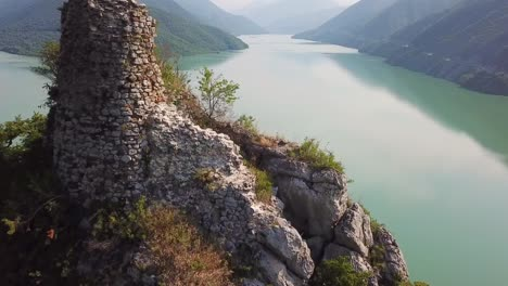 Aerial-Over-An-Abandoned-Ruin-On-Lake-Zhinvali-In-The-Republic-Of-Georgia-1