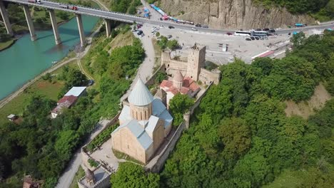 Aerial-Around-A-Beautiful-Castle-And-Church-On-Lake-Zhinvali-In-The-Republic-Of-Georgia