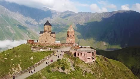 Aerial-Approaching-The-Gergeti-Monastery-And-Church-Overlooking-The-Caucasus-Mountains-In-The-Republic-Of-Georgia