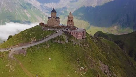 Aerial-Approaching-The-Gergeti-Monastery-And-Church-Overlooking-The-Caucasus-Mountains-In-The-Republic-Of-Georgia-1