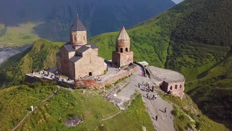 Aerial-Around-The-Gergeti-Monastery-And-Church-Overlooking-The-Caucasus-Mountains-In-The-Republic-Of-Georgia