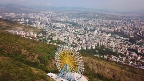 Aerial-Around-The-Tbilisi-Ferris-Wheel-In-The-Republic-Of-Georgia