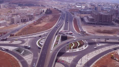 Aerial-Tilt-Down-Of-Traffic-Circle-Or-Roundabout-With-Car-Traffic-Amman-Jordan