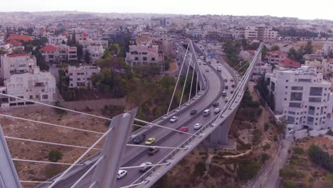 High-Aerial-Over-The-City-Of-Amman-Jordan-And-Abdoun-Bridge-With-Vehicle-Traffic-1