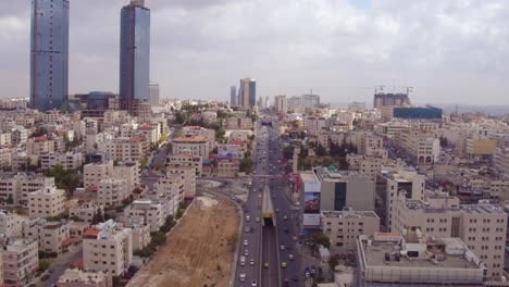 Rising-Aerial-Over-The-City-Of-Amman-Jordan-With-Streets-And-Traffic