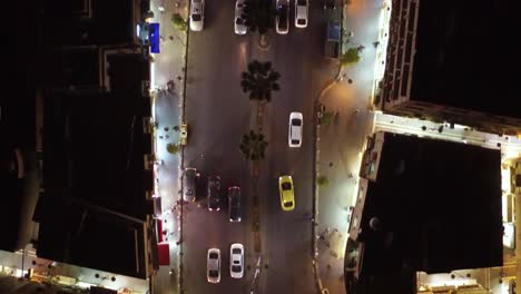 Low-Night-Vista-Aérea-Straight-Down-Following-Cars-Over-The-Old-City-Of-Amman-Jordan-With-Buildings-Traffic-And-Cars-On-Road-1