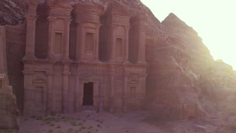 Good-Aerial-Of-A-Man-Standing-And-Looking-At-The-Monastery-Building-In-Petra-Jordan-1