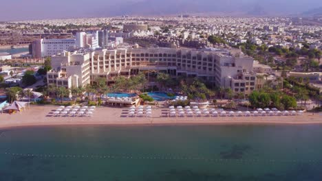 Aerial-Over-The-City-Of-Aqaba-Jordan-With-Large-Hotels-And-Beaches