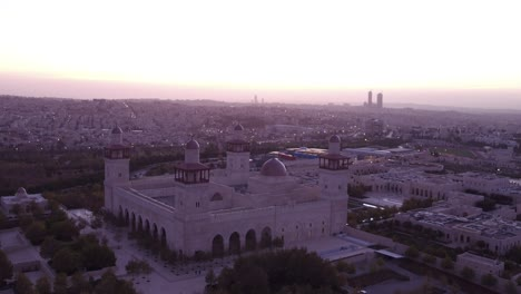 Amazing-Aerial-Shot-Over-A-Mosque-In-Downtown-Amman-Jordan-As-The-Lights-Come-On-At-Dusk