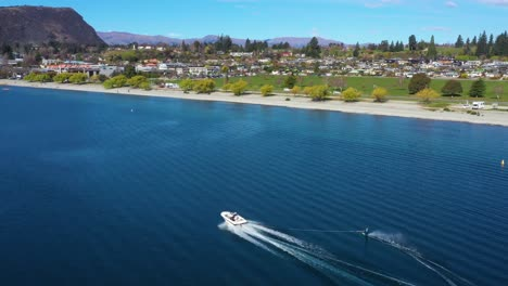 Aerial-Over-A-Water-Skier-Water-Skiing-On-Lake-Wakatipu-In-The-South-Island-Of-New-Zealand