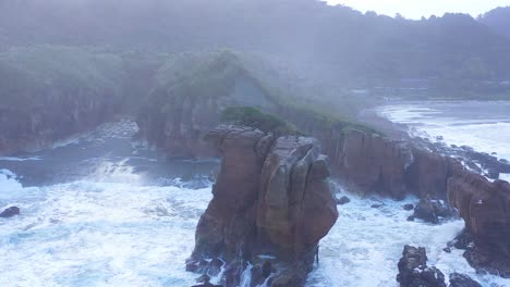 Aerial-Around-The-Pancake-Rocks-Geological-Formations-On-The-Coast-Of-South-Island-Of-New-Zealand