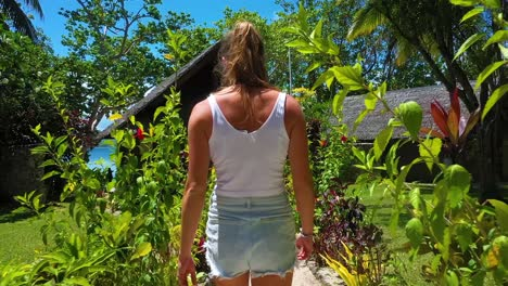 Pov-Following-A-Young-Tourist-Woman-From-Behind-To-A-Hotel-Or-Hut-Resort-On-Vanuatu-Pacific-Islands-Melanesia