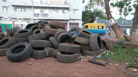 Old-Used-Tires-Are-Dumped-Beside-The-Road-In-Bissau-In-Guineabissau-West-Africa