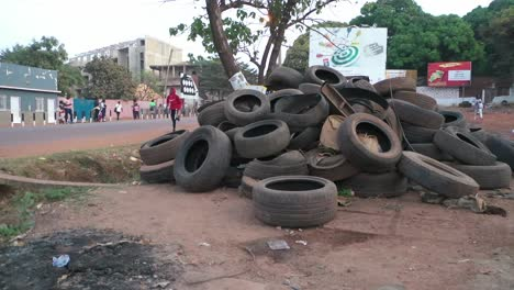 Old-Used-Tires-Are-Dumped-Beside-The-Road-In-Bissau-In-Guineabissau-West-Africa-1