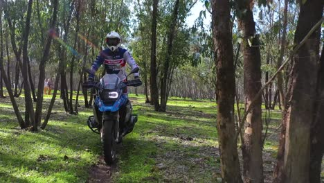 A-Dirt-Bike-Motorcycle-Rider-Drives-Through-A-Forest-Area