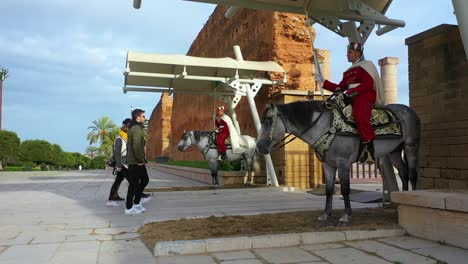 Tourists-Walk-Into-An-Ancient-City-In-Morocco-Guarded-By-Traditional-Moroccan-Horsemen