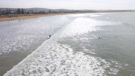 Aerial-Over-Surfers-Enjoying-Waves-And-Surfing-Off-The-Coast-Of-Essaouira-Morocco