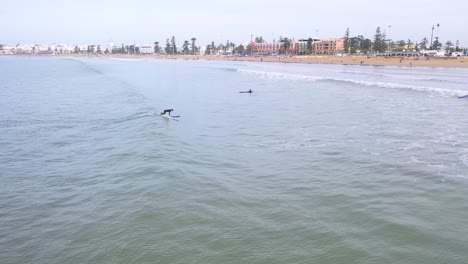 Aerial-Over-Surfers-Enjoying-Waves-And-Surfing-Off-The-Coast-Of-Essaouira-Morocco-1