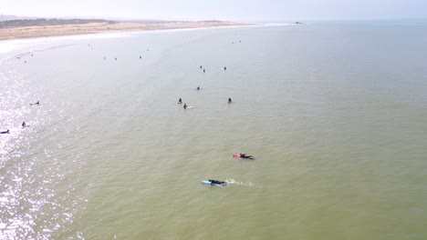 Aerial-Over-Surfers-Enjoying-Waves-And-Surfing-Off-The-Coast-Of-Essaouira-Morocco-4