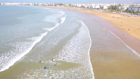 Aerial-Over-Surfers-Enjoying-Waves-And-Surfing-Off-The-Coast-Of-Essaouira-Morocco-5