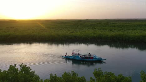 Beautiful-Aerial-Over-Small-Boat-Moving-Along-The-Gambia-River-In-West-Africa-Through-Mangrove-Forests-And-Winding-Bends-1