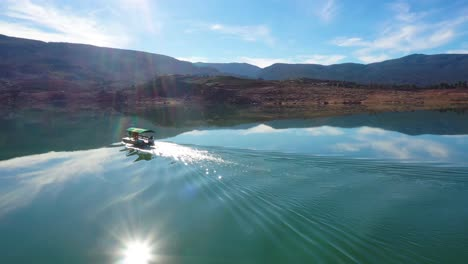 Aerial-Over-Pontoon-Tourist-Boat-On-Lake-Bin-El-Ouidane-Morocco