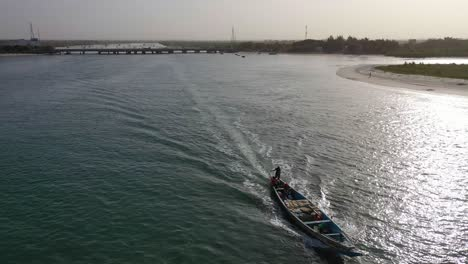 Beautiful-Aerial-Over-Long-Boat-Moving-Along-The-Gambia-River-In-West-Africa-Through-Mangrove-Forests-And-Winding-Bends-4
