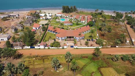 Aerial-Over-A-Hotel-Or-Large-Estate-On-The-Coast-Of-Gambia-West-Africa