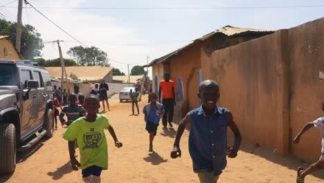 Children-Run-In-Slow-Motion-On-A-Dirt-Road-In-West-Africa