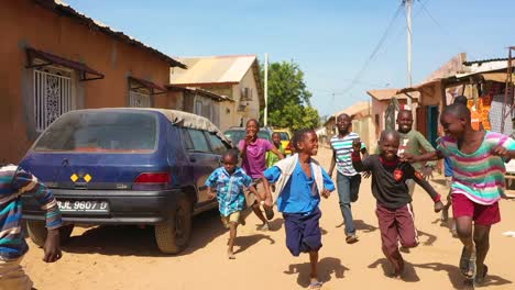 Children-Run-In-Slow-Motion-On-A-Dirt-Road-In-West-Africa-1