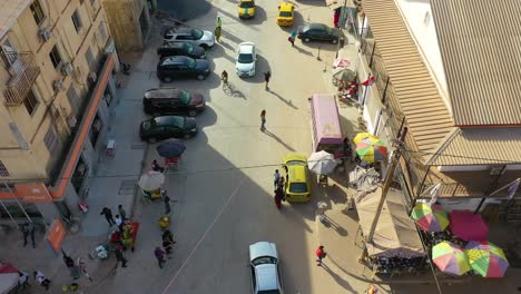 Very-Good-Aerial-Over-West-African-Street-With-Skateboarders-In-Gambia-Passes-For-Guinea-Bissau-Sierra-Leone-Nigeria-Ivory-Coast-Or-Liberia