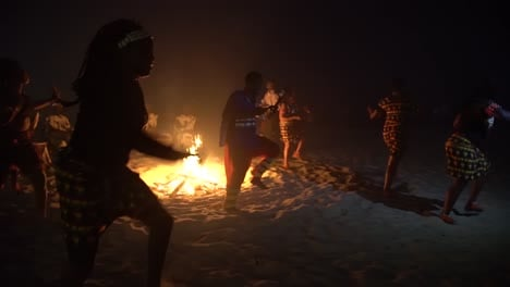 African-Tribal-Dancers-Dance-To-Drum-Rhythms-In-Front-Of-A-Bon-Fire-In-West-Africa