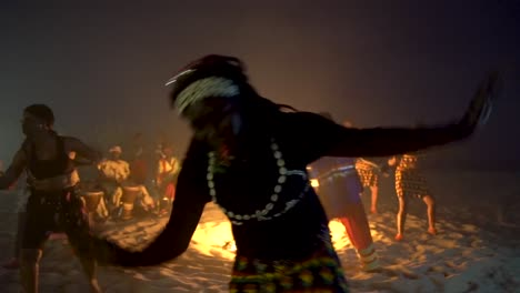 African-Tribal-Dancers-Dance-To-Drum-Rhythms-In-Front-Of-A-Bon-Fire-In-West-Africa-2