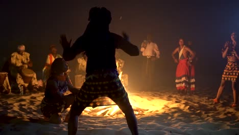 African-Tribal-Dancers-Dance-To-Drum-Rhythms-In-Front-Of-A-Bon-Fire-In-West-Africa-3
