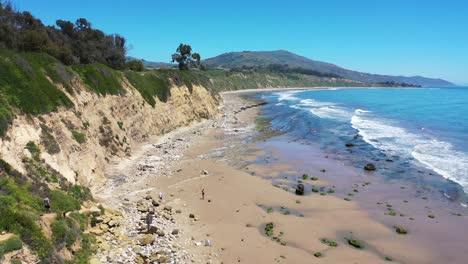 Aerial-Over-People-Enjoying-The-Beautiful-Coastline-Of-Santa-Barbara-California-Near-Carpinteria-Bluffs