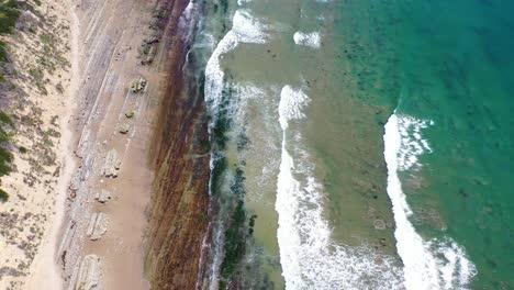 Aerial-Looking-Straight-Down-At-Ocean-Waves-Breaking-On-A-Rocky-Coast-Near-Carpinteria-Santa-Barbara-California