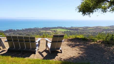 Aerial-Over-Outdoor-Furniture-And-View-Of-Carpinteria-California-And-Establishing-Santa-Barbara-Coastline-Below-1