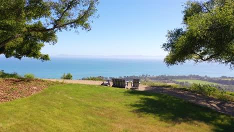 Aerial-Over-Outdoor-Furniture-And-View-Of-Carpinteria-California-And-Establishing-Santa-Barbara-Coastline-Below-2