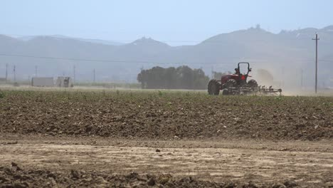 Farm-Tractor-Moves-Across-Dry-Dusty-Landscape-In-California-Suggesting-Drought-And-Climate-Change-3