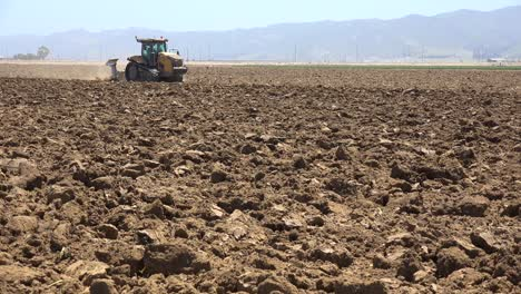 Farm-Tractor-Moves-Across-Dry-Dusty-Landscape-In-California-Suggesting-Drought-And-Climate-Change-4