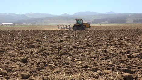 Farm-Tractor-Moves-Across-Dry-Dusty-Landscape-In-California-Suggesting-Drought-And-Climate-Change-5