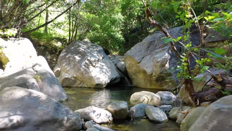 Slow-Aerial-Towards-A-Waterfall-And-Stream-Pool-Water-Flowing-In-Santa-Ynez-Mountains-California