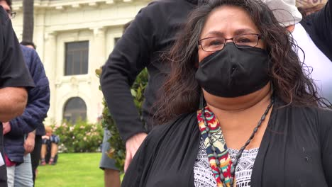 American-Indian-Woman-Burns-Incense-At-Chumash-Native-American-Protest-Against-Father-Junipero-Serra-Statue-In-Front-Of-City-Hall-Ventura-California