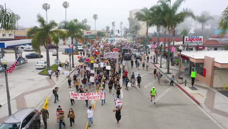 Excellent-Vista-Aérea-Over-Crowds-Large-Black-Lives-Matter-Blm-Protest-March-Marching-Through-A-Small-Town-Ventura-California
